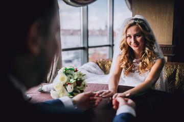 Happy bride and groom in royal vintage interior of restaurant