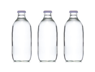 three small glass water bottle