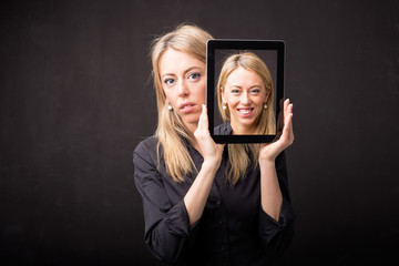Woman showing happy portrait on tablet