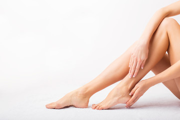 Female taking care of her feet