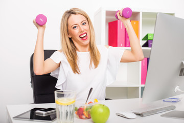 Happy woman in office being active