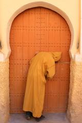 Man opening door in Rissani