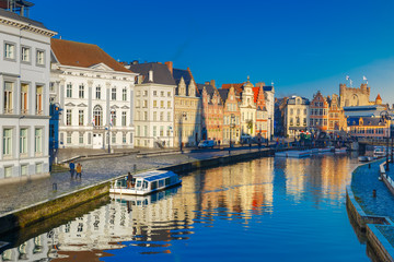 Picturesque medieval buildings on quay Korenlei and  quay Graslei,  Leie river in the morning, blue hour, Ghent, Belgium