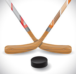 Hockey sticks and hockey puck.  Illustration 10 version