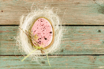 Wall Mural - Homemade Easter cookies in shape of egg on old wooden table