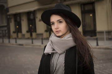 Closeup portrait of beautiful young woman in hat