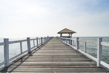 The wooden bridge walkway into the sea.