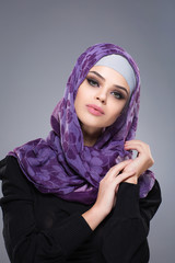 A woman in a Muslim scarf