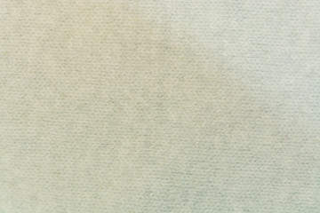 The white woolen fabric closeup with patterns