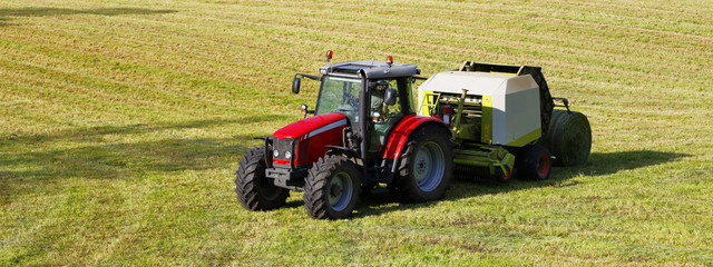 large farming tractor and combi for hay-bales, panoramic view