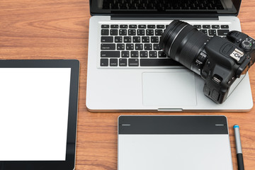 DSLR digital camera with tablet and notebook laptop