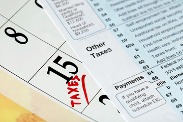 A red tax mark on date of 15th and tax form, close up
