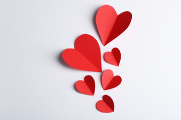 Red paper hearts isolated on white background, close up