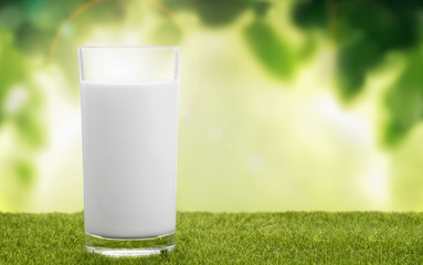 A glass of milk on natural background