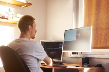 man working at home office computer