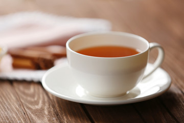 Cup of tea on wooden table closeup