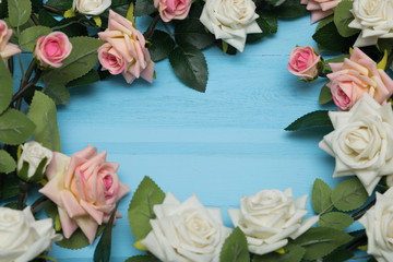 Bouquet of roses on blue wooden background