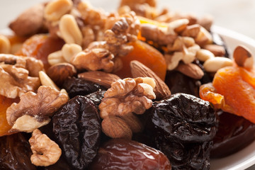 Mix of dried fruits with nuts closeup