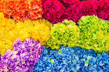 bunch of colorful artificial flowers for craft or bouquet