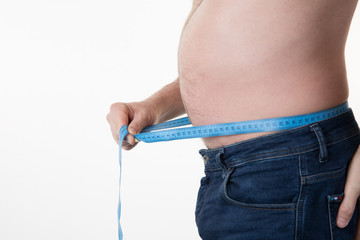 Belly of a man and measuring tape isolated on white