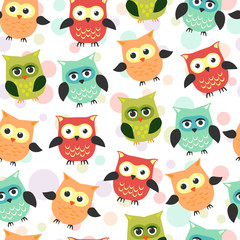 Seamless pattern with owls in cartoon style