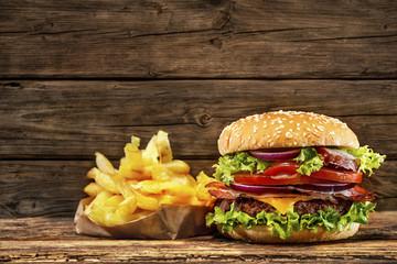 Fototapeta Delicious hamburger on wooden table obraz