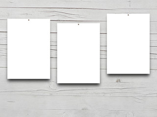 Close-up of three nailed blank frames on monochrome wooden boards background