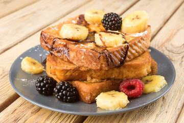 French toast with banana and berries Wall mural