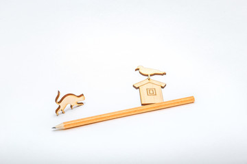 Miniature items - house and cat on white background