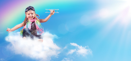 Fotobehang - Full-Color Adventure - Child Flying On The Cloud With Airplane And Rainbow