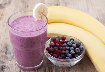 Smoothie of banana, berries frozen cranberries and blueberries w