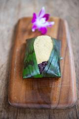 Thai dessert. Black sticky rice with egg custard.