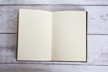 Classic Leather Bound Journal Book Open on a White Barn Board Floor