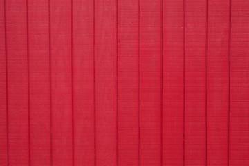 Worn rustic red barn board paneling texture