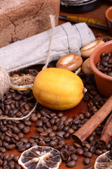 Vintage still life with coffee beans on wooden background