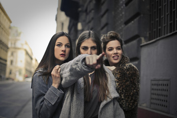 Women pointing at someone