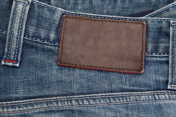 blue jeans with brown leather tag
