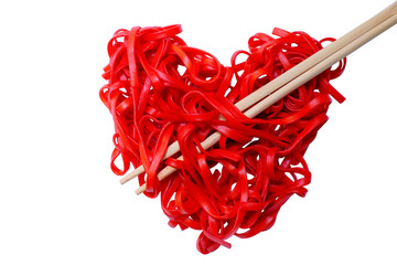 cooked red pasta arranged in a heart shape. red heart-shaped spaghetti and chopsticks, symbolizing the arrow pierces the heart. isolated on white background