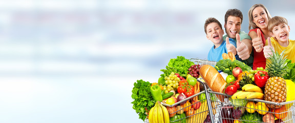 Wall Mural - Happy family with grocery shopping cart.