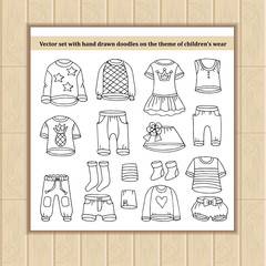 Vector set with hand drawn isolated doodles of clothes for boys and girls