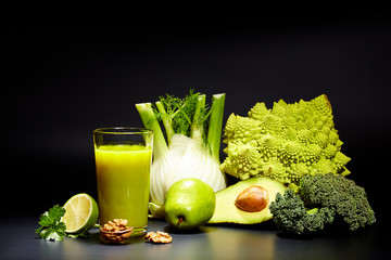 healthy vegetable juices for refreshment and as an antioxidant . Black background