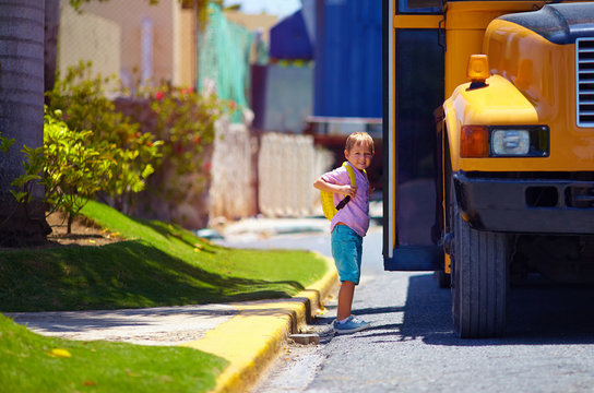 cute kid are getting on the bus, ready to go to school