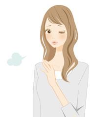 肩こりに悩まされる女性 ため息