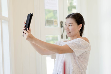 Women taking Photos with tablet