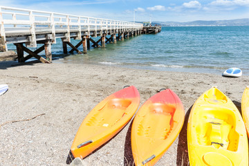 Summer day at Days Bay and wharf  yellow kayaks on beach Wellington, New Zealand beach,