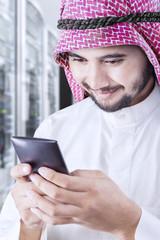 Arabic entrepreneur messaging on mobile phone