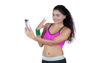 Cheerful athlete taking selfie photo