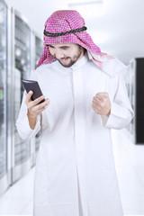 Muslim entrepreneur using a mobile phone