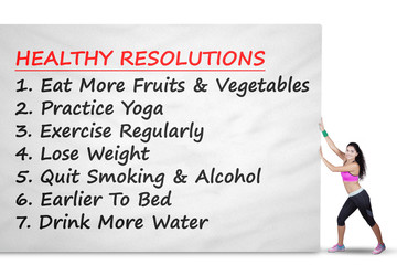 Woman pushes banner with healthy resolutions