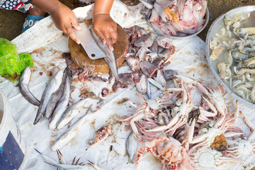 Butchering fish in street market of Thailand